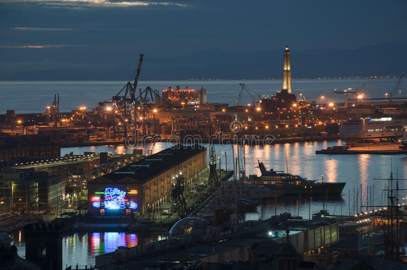 Genoa by night. Genoa harbour night view with lighthouse stock images