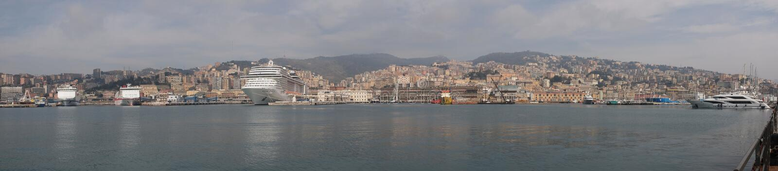 Genoa panorama. Wide panoramic view of the city of Genoa skyline from the sea royalty free stock image