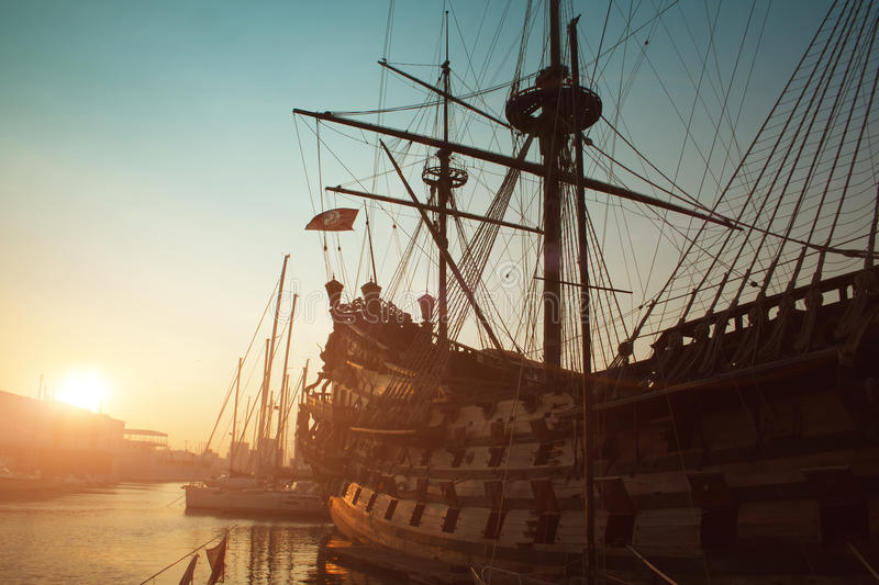 Genoa view. Old big ship in port of Genoa on sunset royalty free stock images