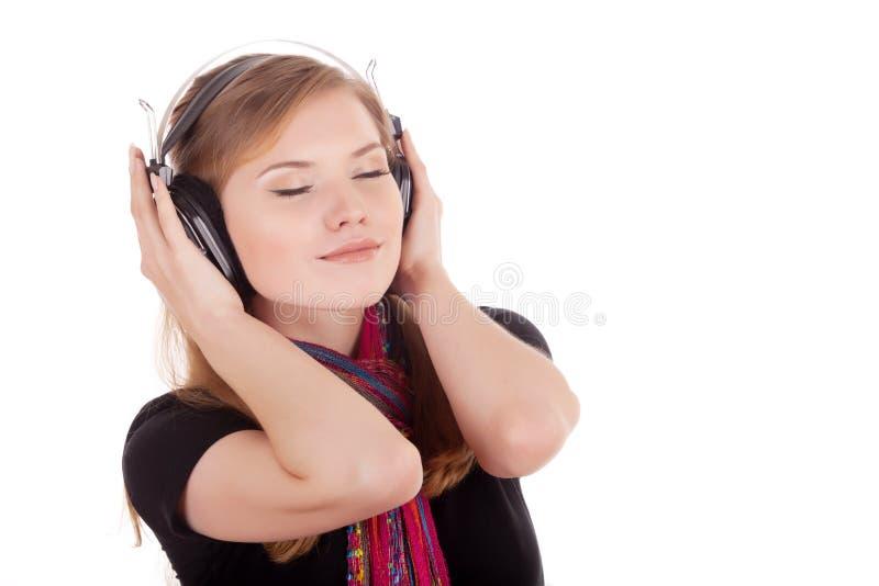 Genoegen van het luisteren aan muziek royalty-vrije stock afbeeldingen