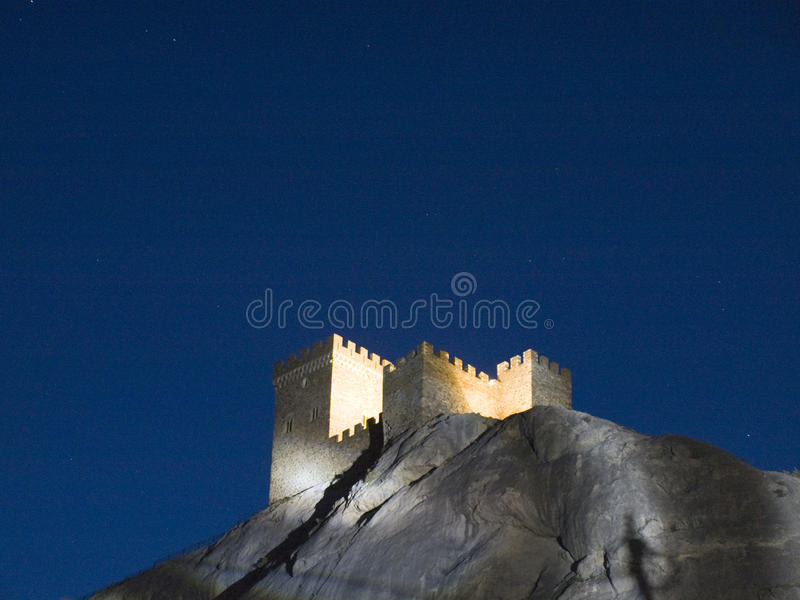 Genoese Fortress Illuminated In The Mountains At Night Stock Photo