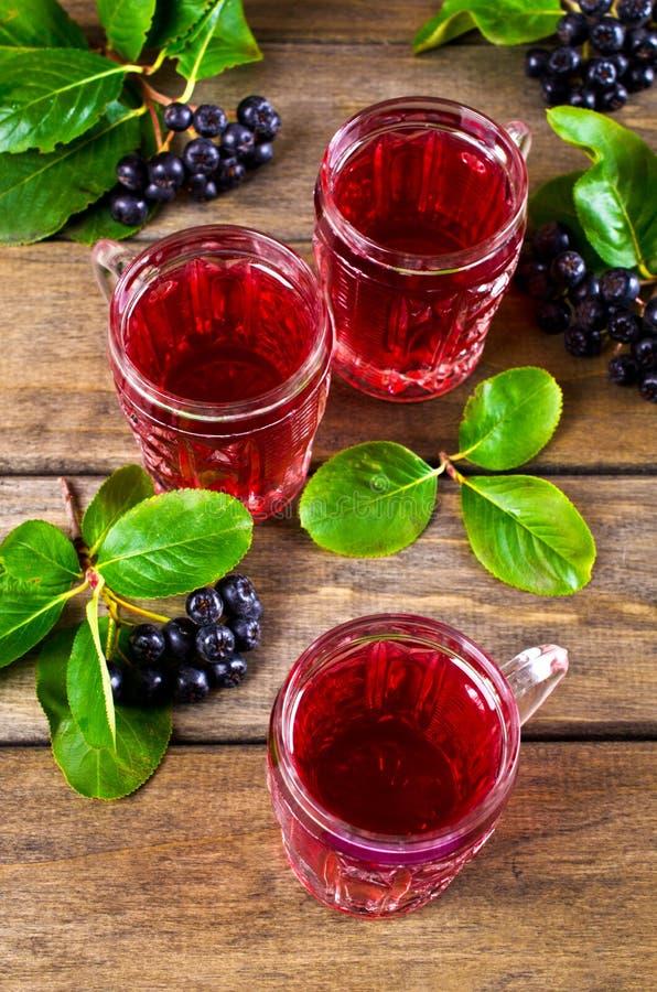Download Genomskinlig röd drink fotografering för bildbyråer. Bild av exponeringsglas - 76702441