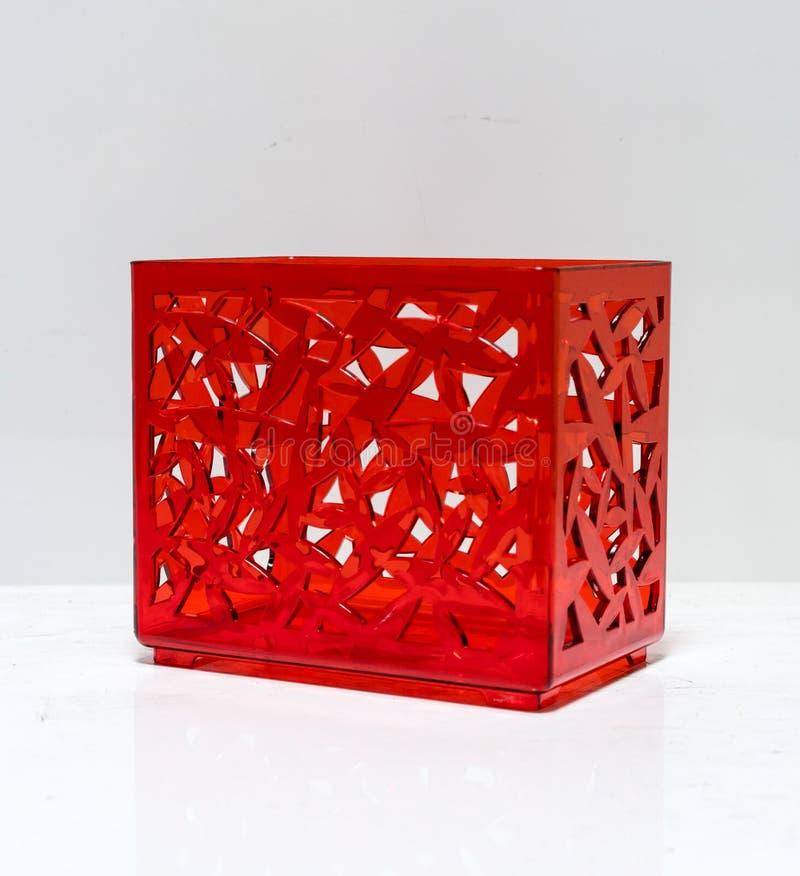 Genomskinlig röd plast- ask med den perforerade modellkroppen royaltyfri fotografi