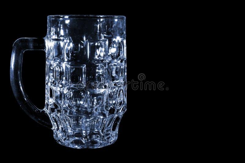 Genomskinligt ölexponeringsglas som isoleras på svart bakgrund arkivbild