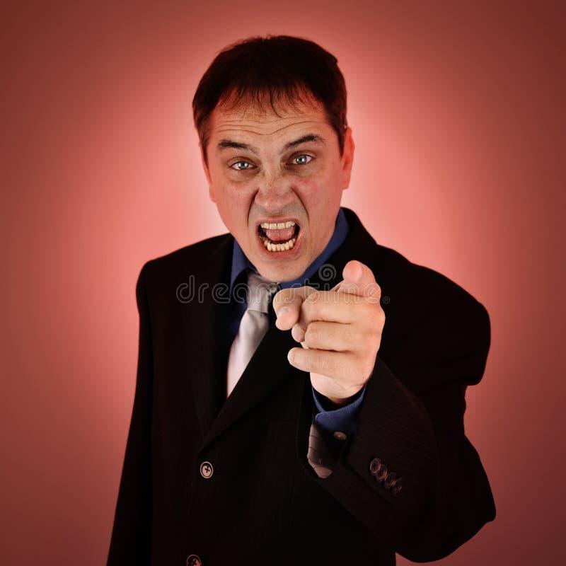 Genomsnittligt ilsket framstickande Pointing Finger arkivfoton