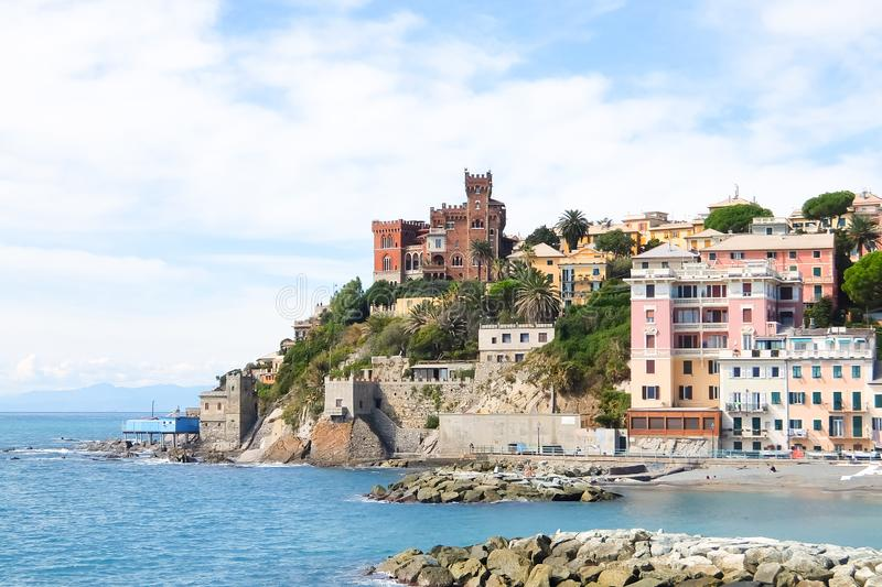 Beautiful view of Vernazzola Beach, colorful houses village in Genoa, Italy stock photo