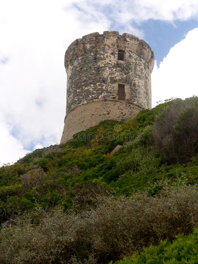 Genovese tower on the Corsican coast royalty free stock photo