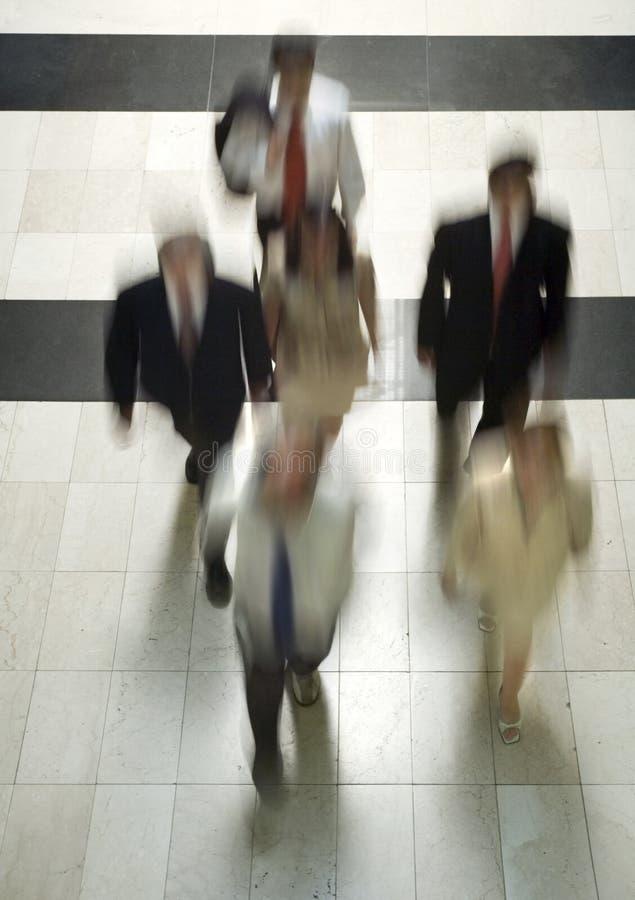Gens d'affaires allant fonctionner 4 images libres de droits