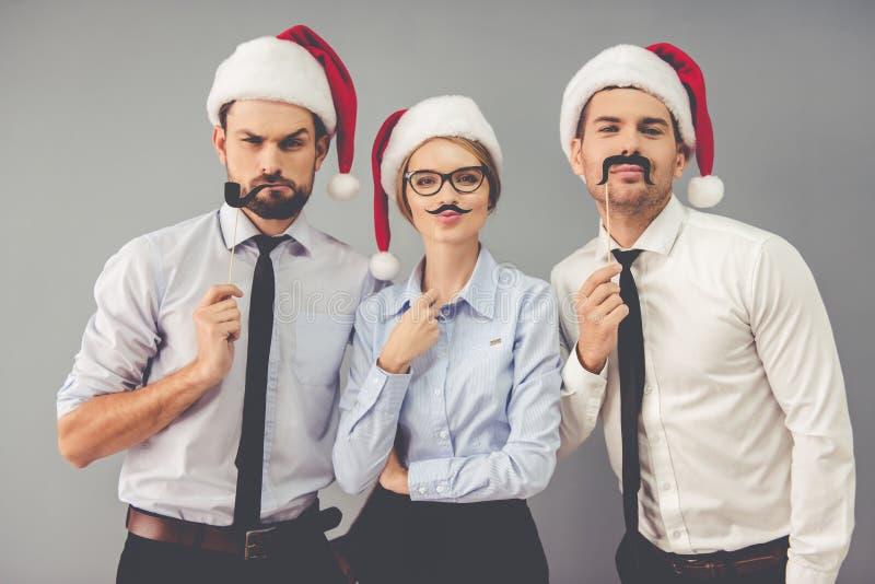Gens d'affaires célébrant Noël photo stock