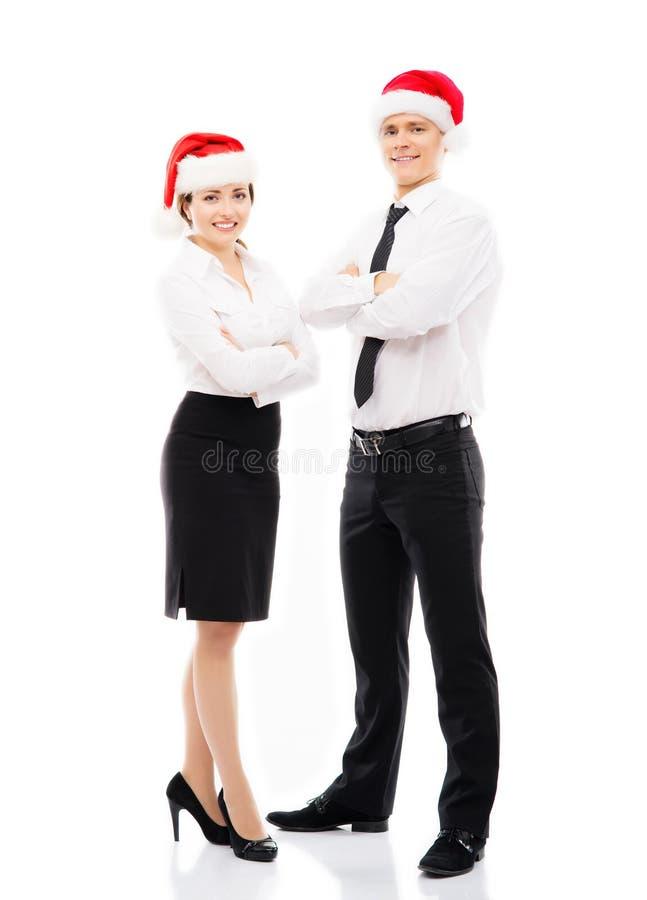 Gens d'affaires dans des chapeaux de Noël photo stock