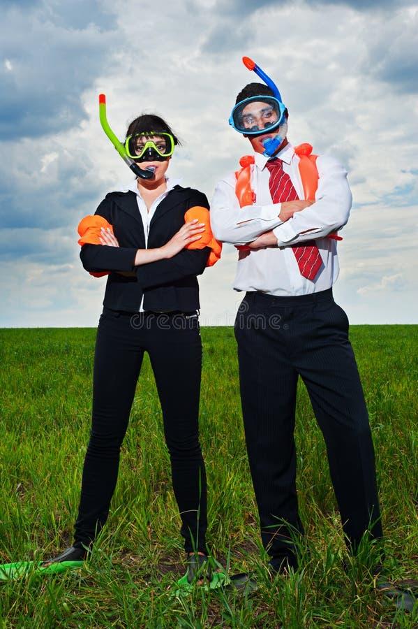 Gens d'affaires dans le masque et les nageoires de scaphandre photo libre de droits