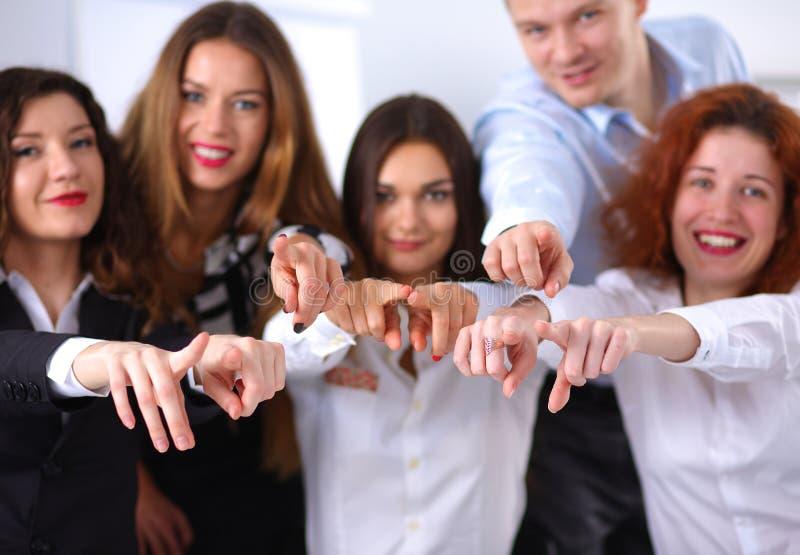 Gens d'affaires de groupe d'équipe de doigt de point à vous photo stock