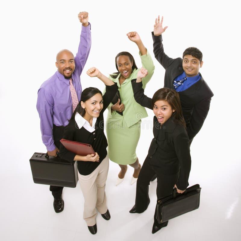 Gens d'affaires encourageant des serviettes de fixation. photo libre de droits