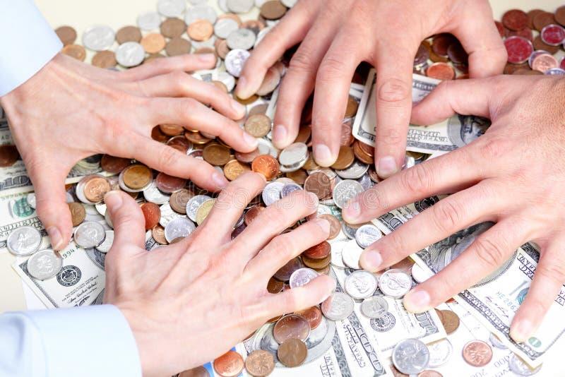 Gens d'affaires et argent images stock