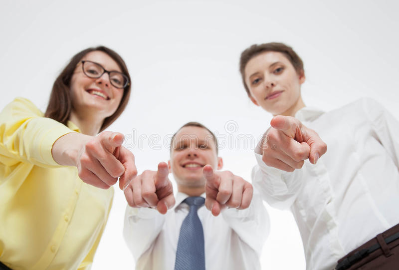 Gens d'affaires raillant au-dessus de quelqu'un photos stock