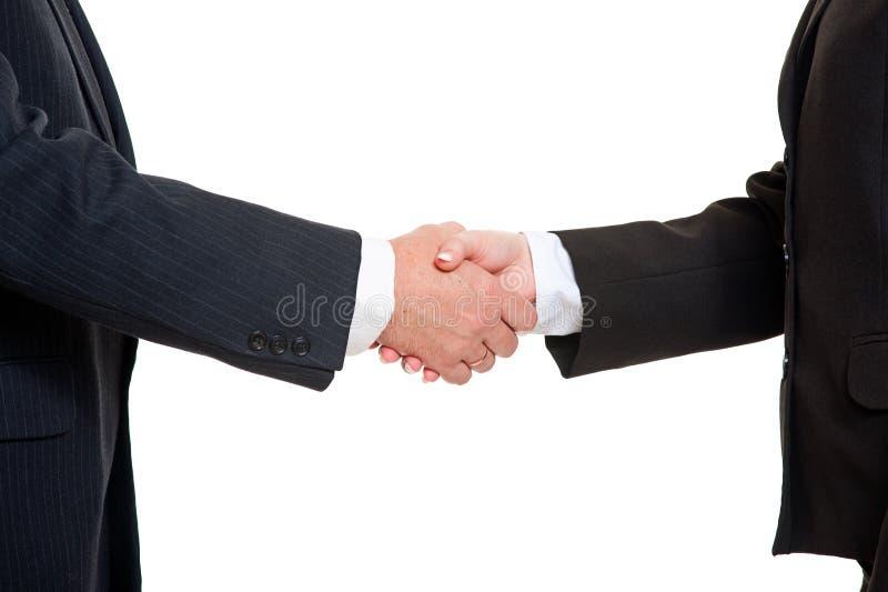 Gens d'affaires se serrant la main images libres de droits
