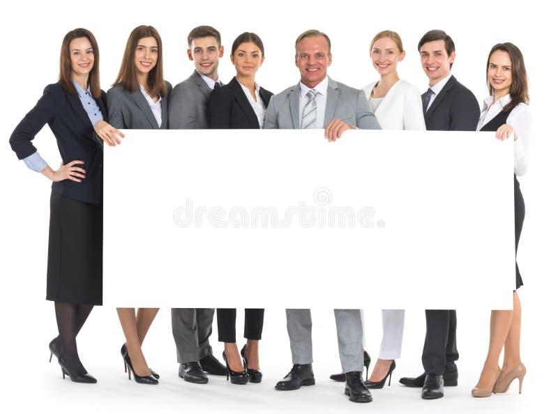 Gens d'affaires tenant une bannière photographie stock libre de droits