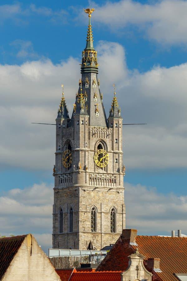 gent Πύργος ρολογιών στο ηλιοβασίλεμα στοκ φωτογραφίες