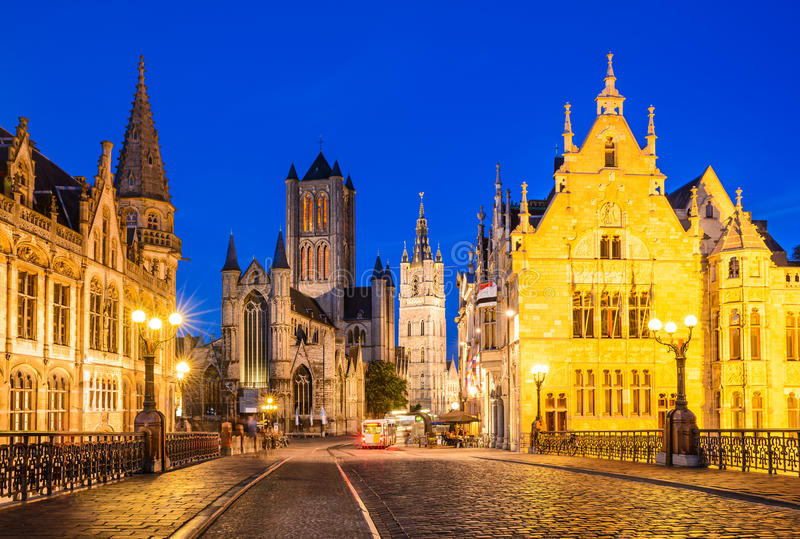 Gent, Belgium. Night image of Saint Nicholas Church and Belfry tower, one of famous landmarks of Ghent, Gent in Flanders, Belgium royalty free stock image
