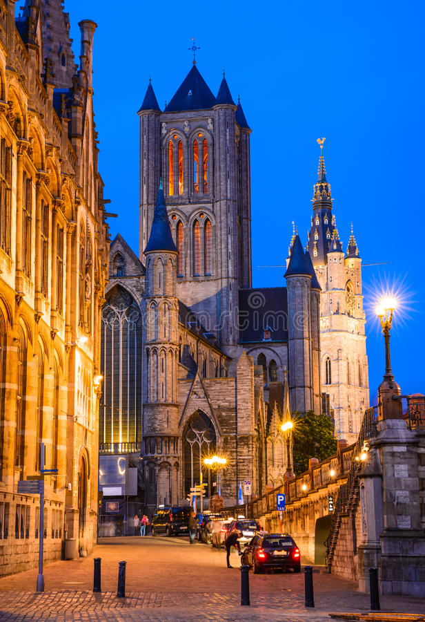 Gent, Belgium. Night image of Saint Nicholas Church and Belfry tower, one of famous landmarks of Ghent, Gent in Flanders, Belgium royalty free stock photos