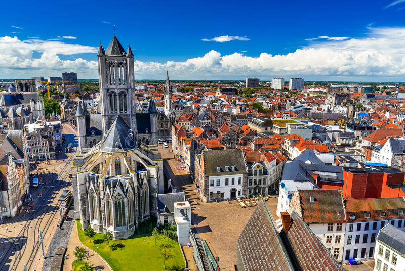 Gent, Belgium. Skyline of Gent, Ghent in West Flanders, Belgium, seen from Belfort tower with St. Nicholas Church royalty free stock images