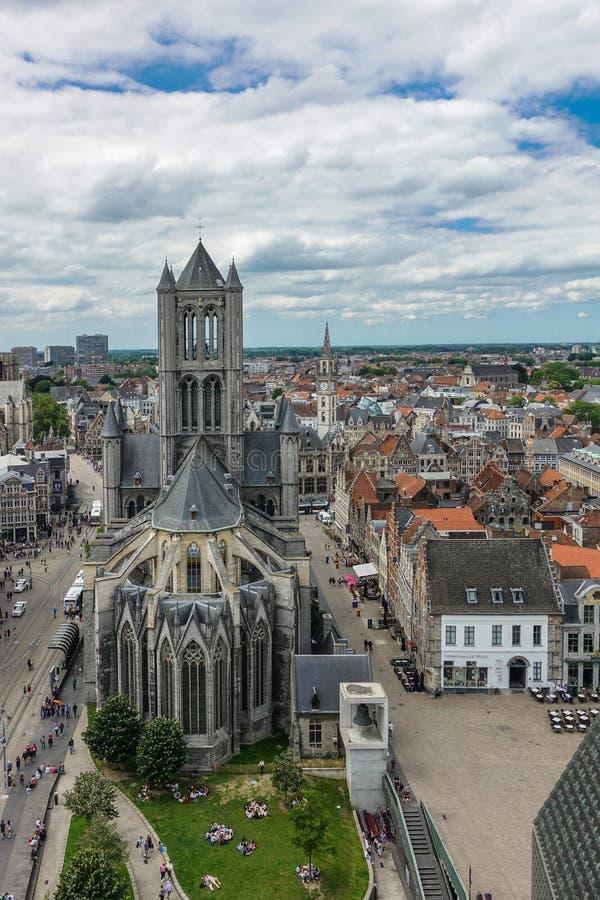 Sint Niklaas church in Gent, Flanders, Belgium. Gent, Flanders, Belgium -  June 21, 2019: Shot from top Belfry. Sint Niklaas Church in middle of cityscape of stock image