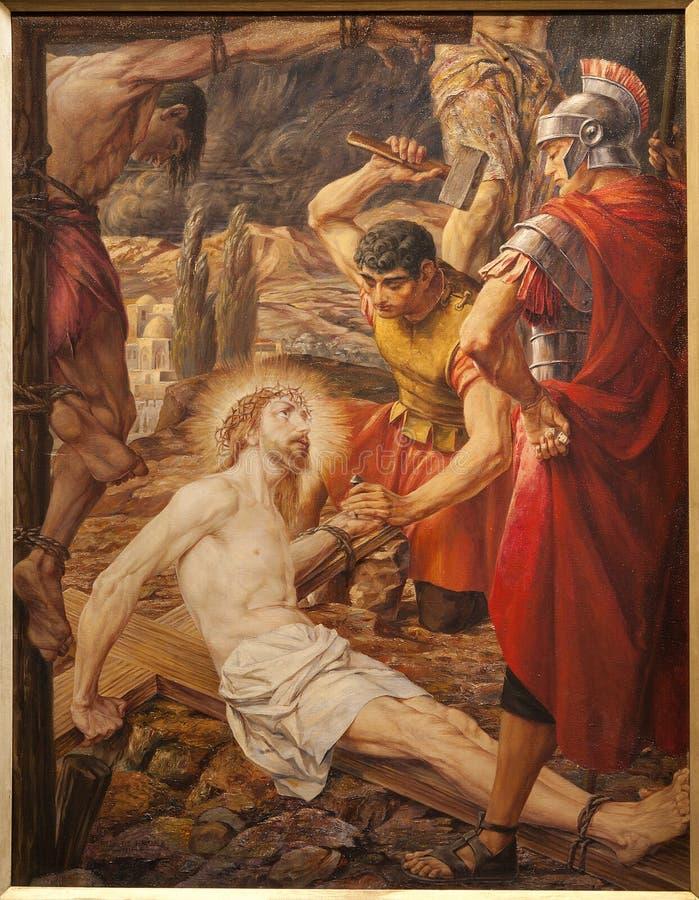GENT - korsfäst Jesus Kristus. Målarfärg i St. Peter royaltyfria bilder