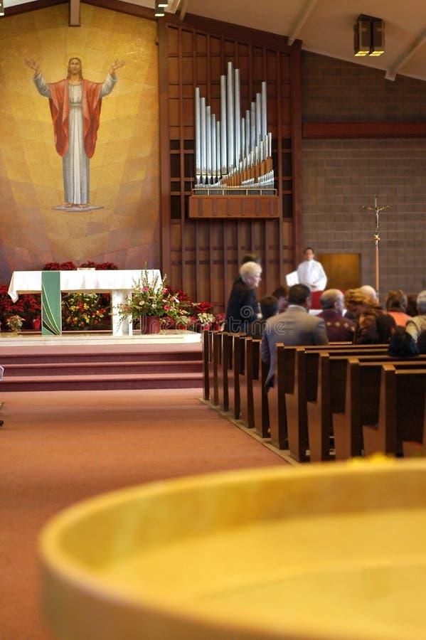 Gente, agua santa en iglesia fotografía de archivo libre de regalías