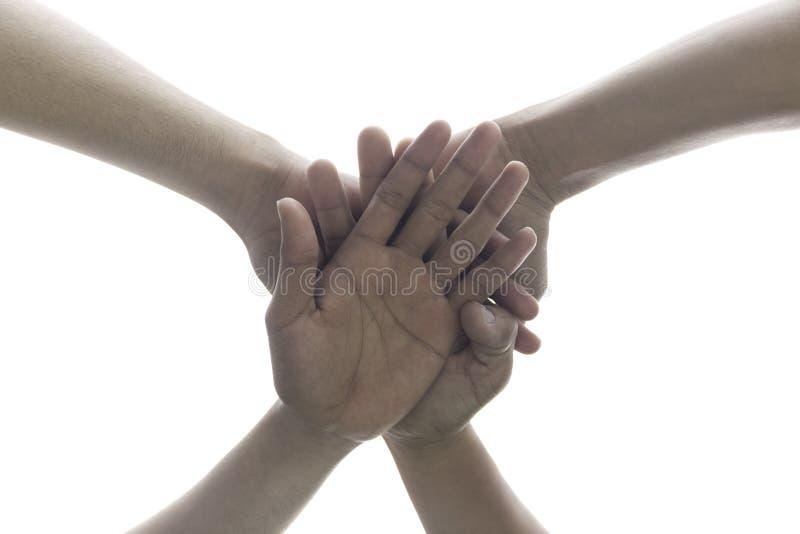 Gente conceptual que pone sus manos que trabajan junto como equipo w foto de archivo