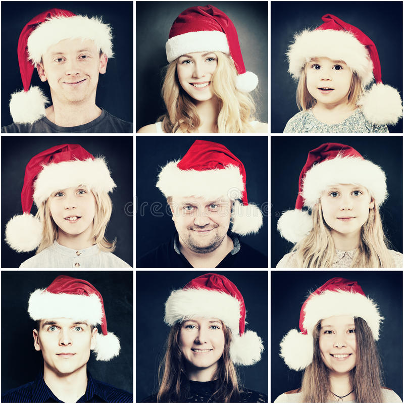 Gente de la Navidad Hombre, mujer y niños en Santa Hat fotos de archivo