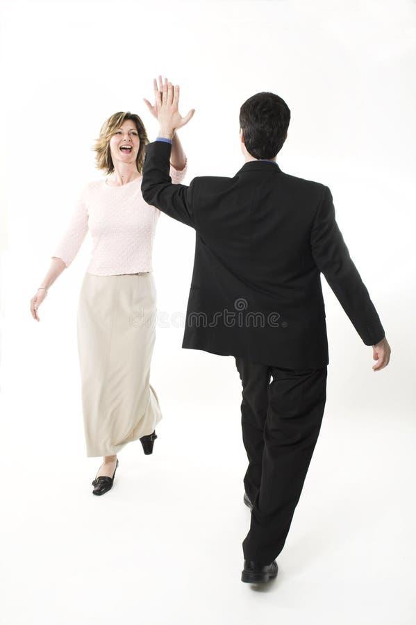 Gente di affari che colpisce le mani leggermente fotografia stock
