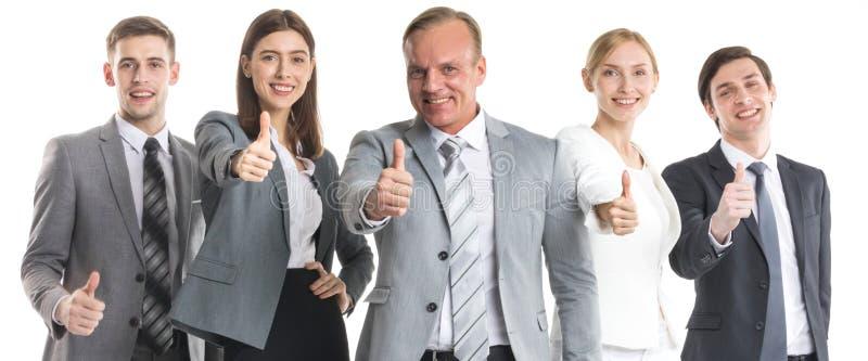 Gente di affari con i pollici in su fotografia stock