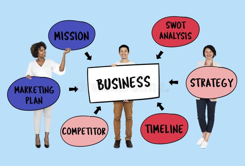 Gente di affari con un piano strategico fotografia stock libera da diritti