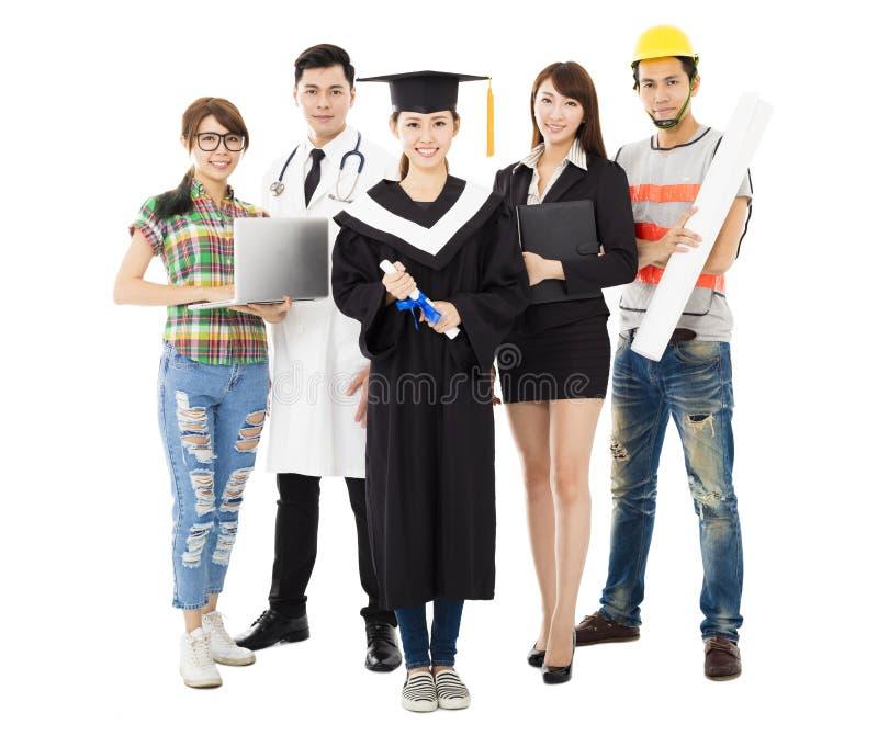 Gente en diversos empleos con la graduación imágenes de archivo libres de regalías