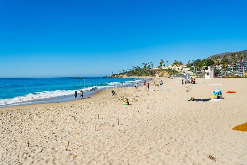 Gente en la playa en el Condado de Orange foto de archivo libre de regalías
