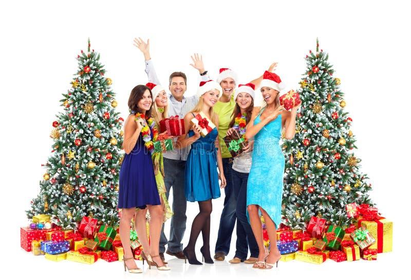 Gente felice con i regali di Natale fotografia stock libera da diritti