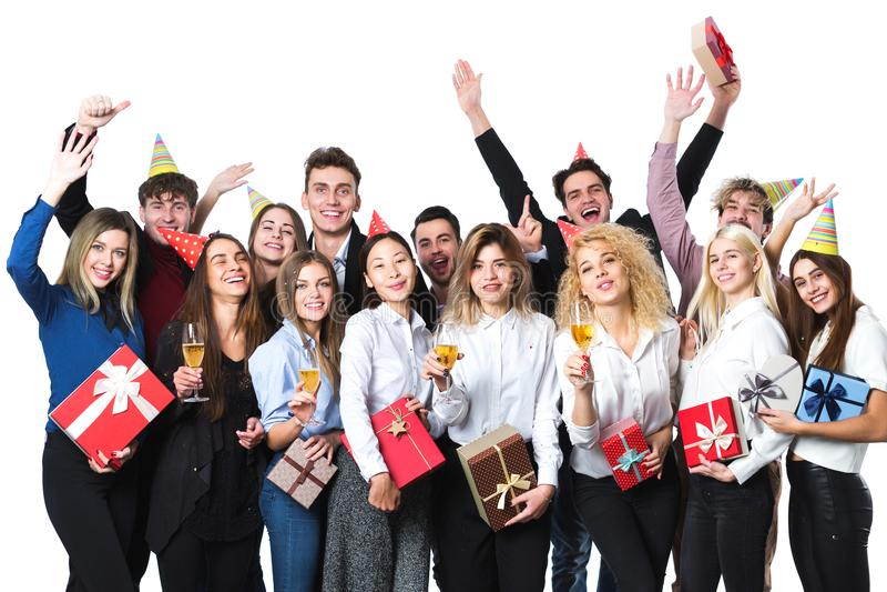 Gente feliz que celebra día de fiesta con champán fotos de archivo