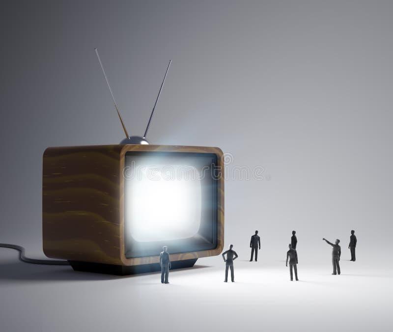 Gente minuscola e un set televisivo d'annata immagini stock libere da diritti