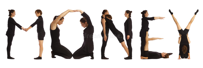 Gente vestita il nero che forma parola dei SOLDI fotografia stock