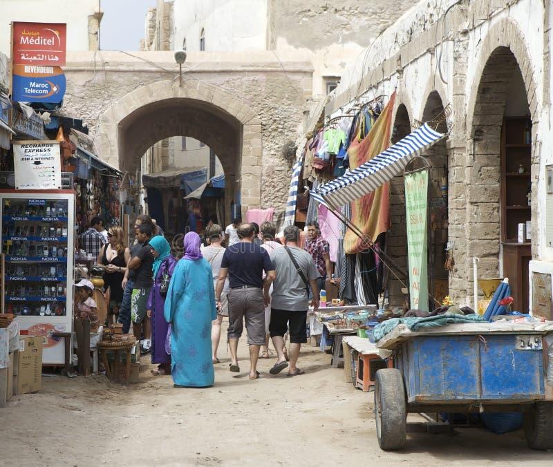 Gente y vendedor ambulante imagen de archivo