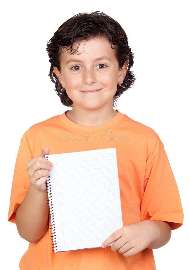 Gentil enfant avec le cahier blanc images stock