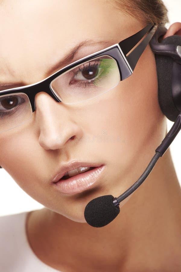 Gentil opérateur de ligne directe avec l'écouteur image libre de droits
