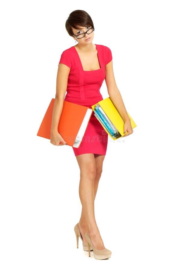 Gentille femme d'affaires dans une robe de corail image stock