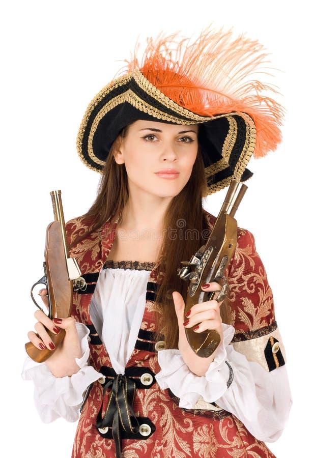 Gentille jeune femme avec des armes à feu photo stock