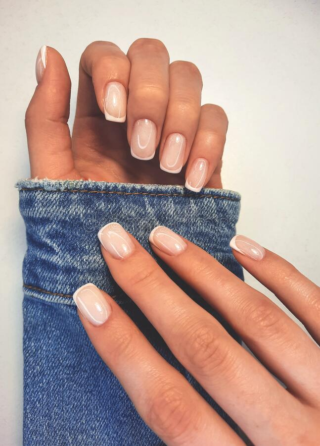 Free Gentle Camouflage Gel Polish On Square Nails With A French Design. Hands With A Professional Manicure In A Denim Jacket. Royalty Free Stock Image - 214923206
