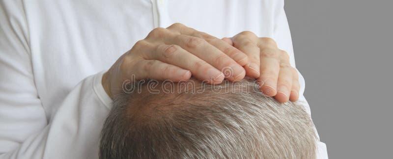 The Gentle Comfort of Hands on Healing stock images