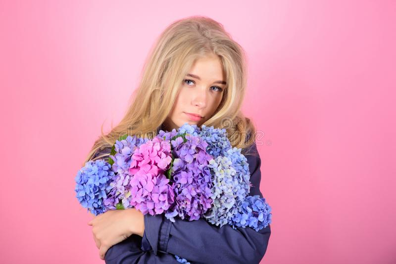 Gentle delicate flower. Pure beauty. Tenderness of young skin. Springtime bloom. Simple beauty. Girl cute blonde hug. Hydrangea flowers bouquet. Natural beauty stock images
