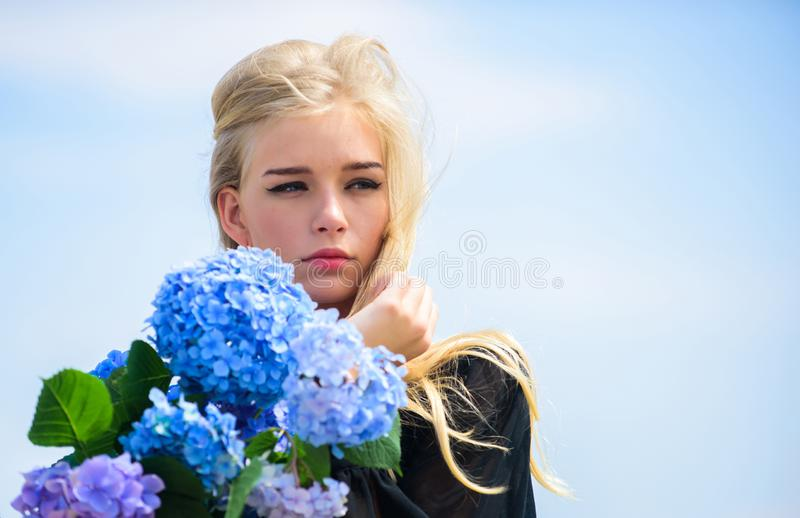 Gentle flower for delicate woman. Pure beauty. Tenderness of young skin. Springtime bloom. Girl tender blonde hold. Hydrangea flowers bouquet. Natural beauty royalty free stock photo