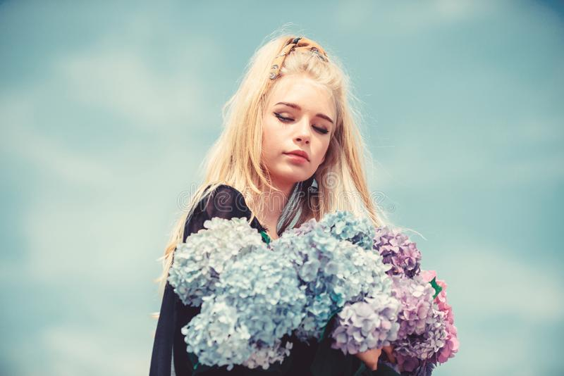 Gentle flowers for delicate woman. Pure beauty. Tenderness of young skin. Beauty of spring season. Girl tender blonde stock photos