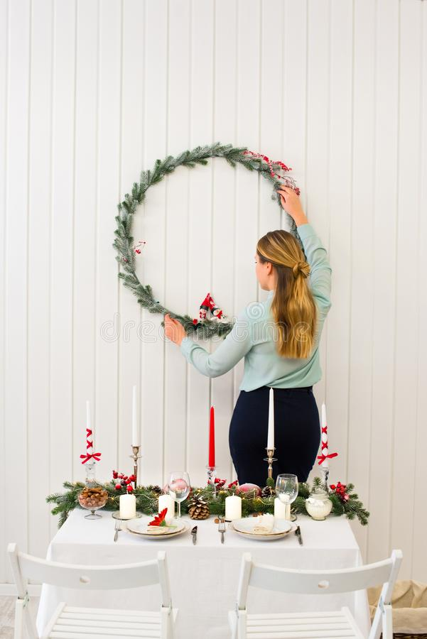 Gentle girl fixing a fine thin christmas royalty free stock image